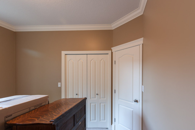 bedroom walls painted brown with white trim work