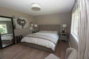 bedroom walls painted in soft grey with white trim