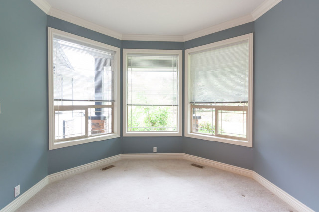 den painted blue with white trim