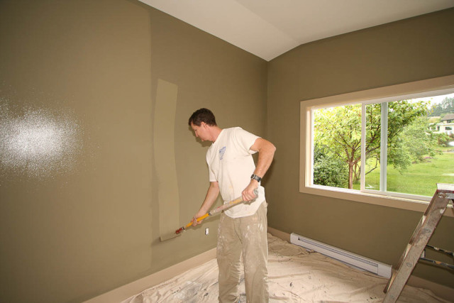 den room walls painted in sage green