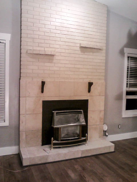 fireplace brick painted in light cream colour to match tile