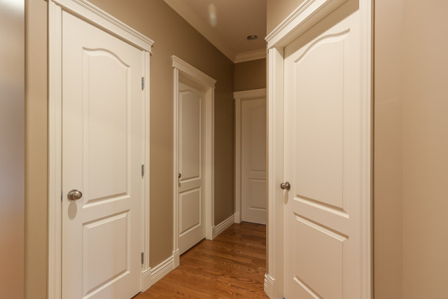 hallway painted in brown colour with white trim work and doors