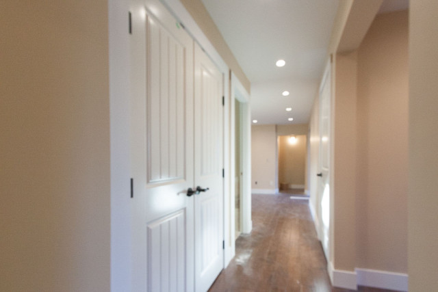 hallway walls painted butter pecan colour with white trim and doors