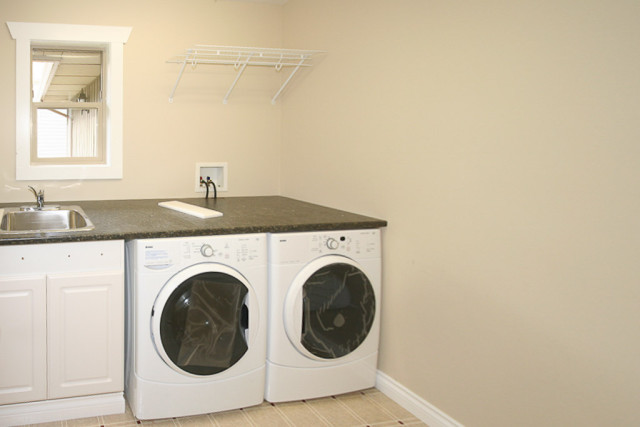 laundry room painted in oatmeal cream colour