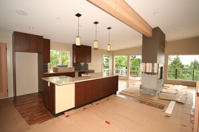 modern kitchen and living room painted in taupe and accent brown