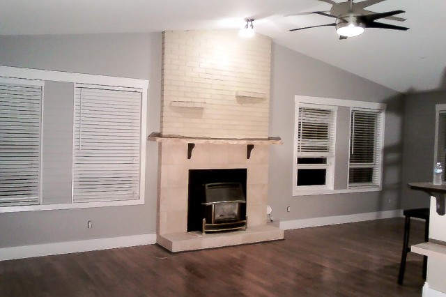painted grey walls with cream coloured fireplace brick