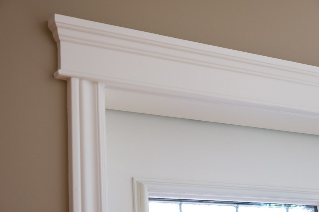 trim work painted in soft cream colour againt brown walls