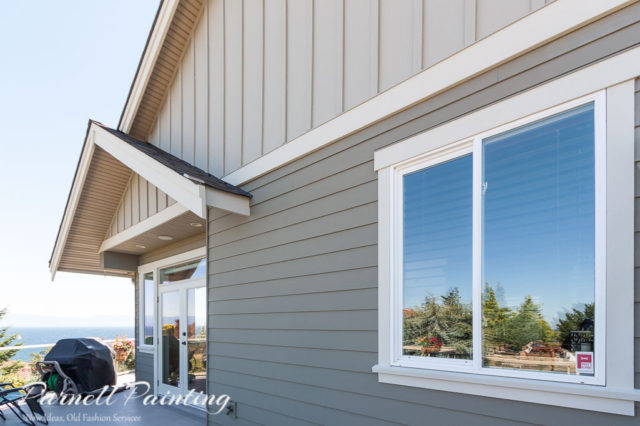 three shades of grey green colour used on exterior house siding trim and gables